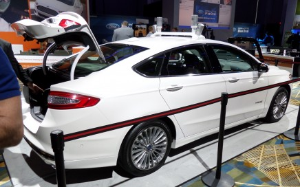 White 2014 Ford Fusion Automated Research Vehicle. Side view.