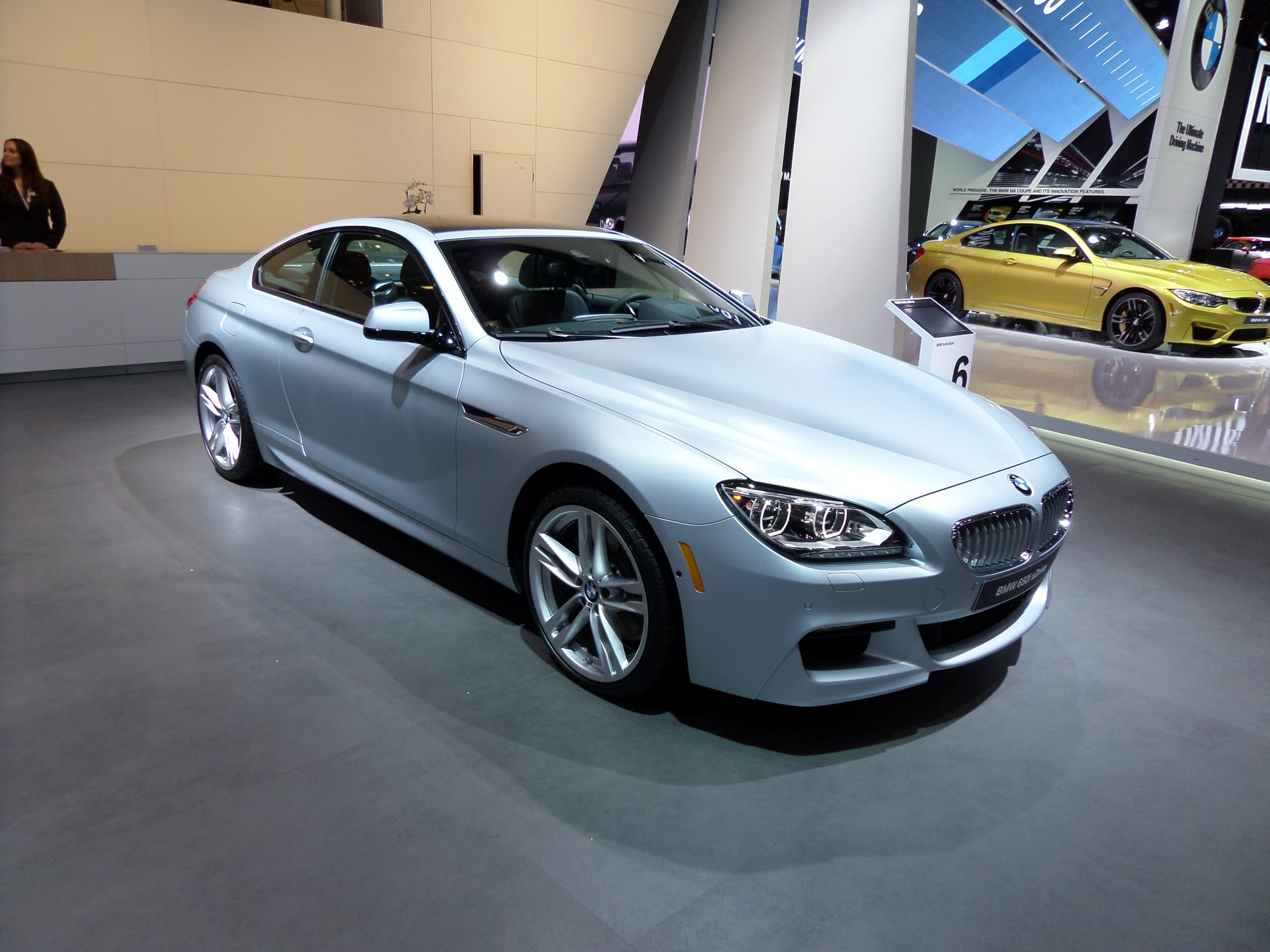A two-door, silver BMW 650i xDrive. Side view.