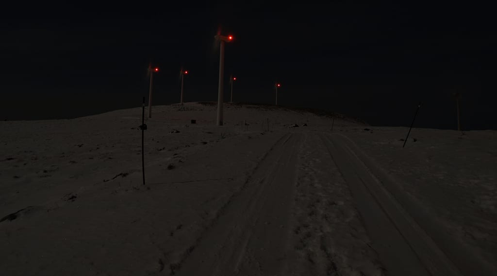 Glowing wind turbines on on a mountain at night.  Image obtained with thanks from: John Christian Fjellestad on Flickr.