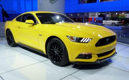 A yellow 2015 Ford Mustang sports car at the NAIAS.